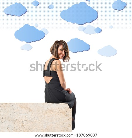 Pretty brunette woman isolated over sky background