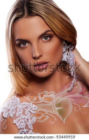 pretty brunette woman with body art as flowers - stock photo