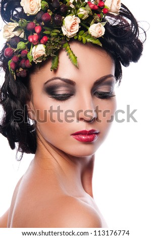 pretty brunette woman with flowers in hair