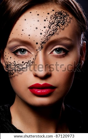 pretty brunette woman with mask on face and magnificent red lips - stock photo