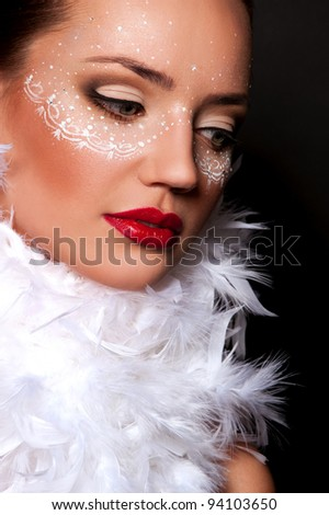 pretty brunette woman with sexy red lips with mask on face in pens on the neck