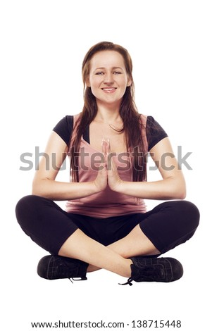 Pretty brunette young woman doing yoga - stock photo