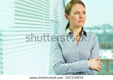 Pretty business lady contemplating about the future of business - stock photo