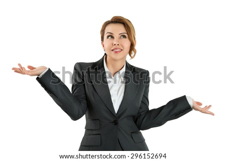 Pretty business woman holding her hands out saying that she does not know isolated over white background. Have no idea concept - stock photo