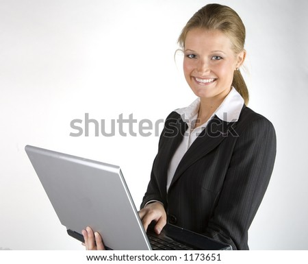 Pretty business woman on laptop computer