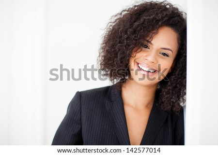 Pretty business woman smiling at camera with closeup - stock photo