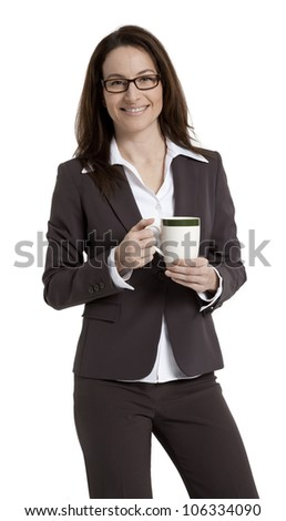 Pretty business woman standing, holding coffee mug, isolated on white.