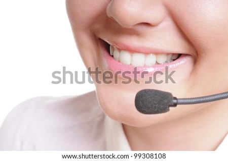 pretty business woman with headset. Over white background - stock photo