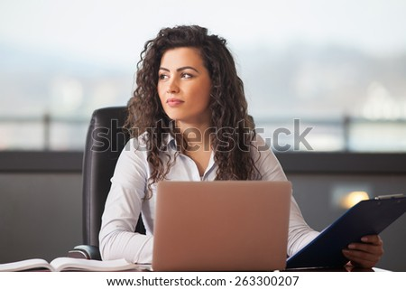 pretty business woman with notebook in the office