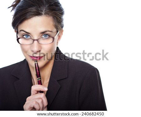 Pretty business woman with suggestive look in studio - stock photo