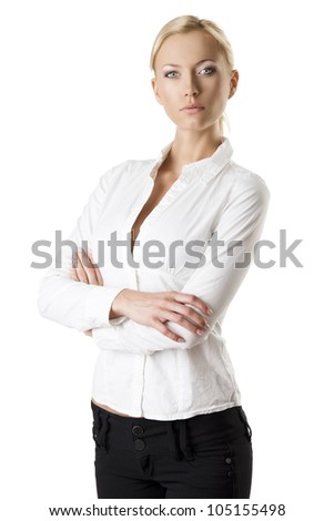 pretty business woman with with white shirt and dark jacket, she looks in to the lens with serious expression and her arms are crossed - stock photo