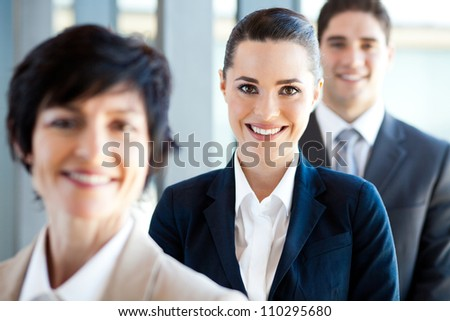 pretty businesswoman and co-workers portrait - stock photo