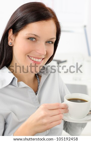 Pretty businesswoman enjoy cup of coffee at modern office - stock photo