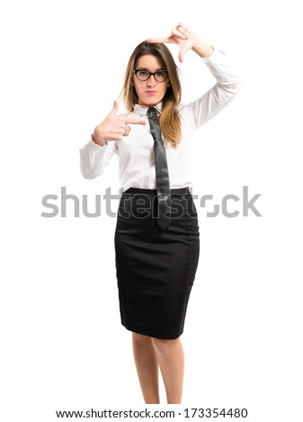 Pretty businesswoman focusing with her fingers on a white background  - stock photo