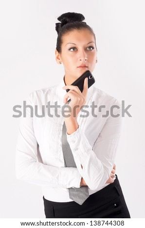 Pretty businesswoman holding mobile phone. At white background - stock photo