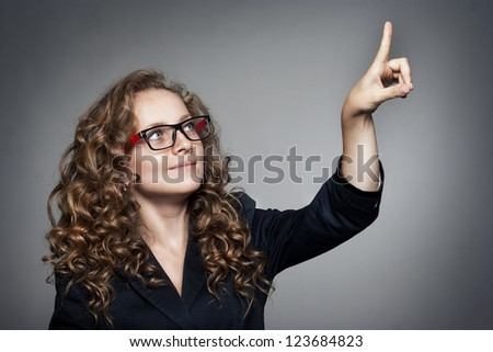 Pretty Businesswoman pointing her finger on empty copy space