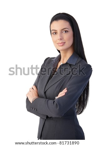 Pretty businesswoman posing with arms crossed,? - stock photo