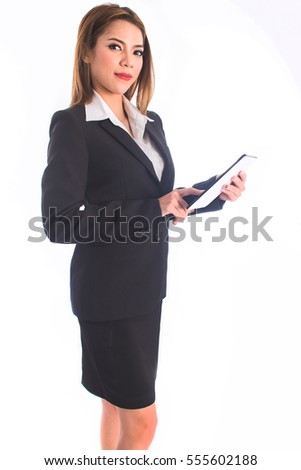 pretty businesswoman smiling using touch pad tablet isolated on white background,