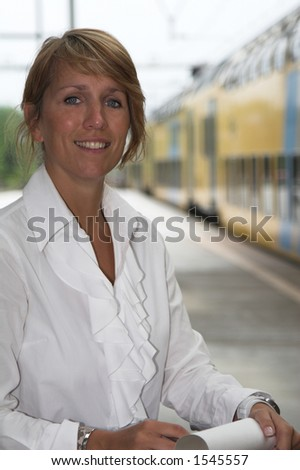 Pretty businesswoman waiting for the train to arrive - stock photo