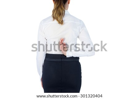 Pretty businesswoman with finger crossed against a white wall - stock photo