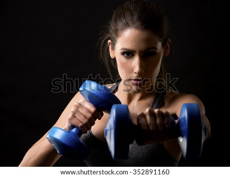 pretty caucasian fitness woman on black isolated background  - stock photo