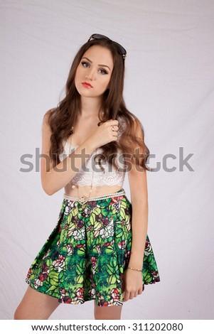 Pretty Caucasian girl looking thoughtful - stock photo