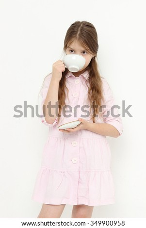 Pretty caucasian teen with china teacup - stock photo