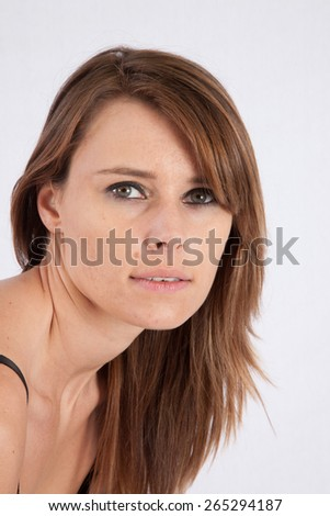 Pretty Caucasian woman, looking thoughtfully at the camera