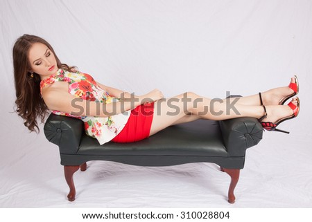 Pretty Caucasian woman reclining and  looking thoughtful - stock photo