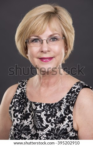 pretty caucasian woman wearing dress on dark background - stock photo
