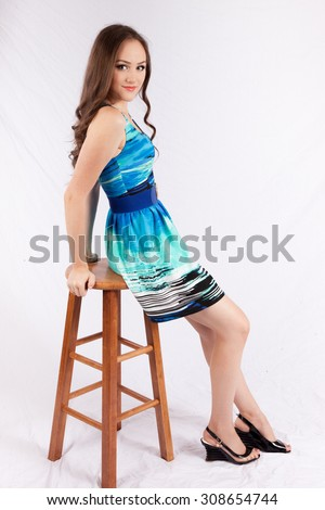 Pretty Caucasian woman with long hair, looking thoughtful - stock photo