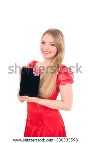 Pretty cheerful  girl in a santa hat on new year holding tablet computer touch pad gadget with isolated black screen and red bow - stock photo