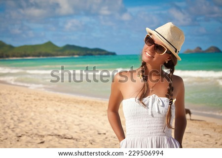 Pretty cheerful woman relaxing at the luxury resort. Beauty in the summer sun. Summer luxury vacation. Hawaiian Island of Oahu - stock photo