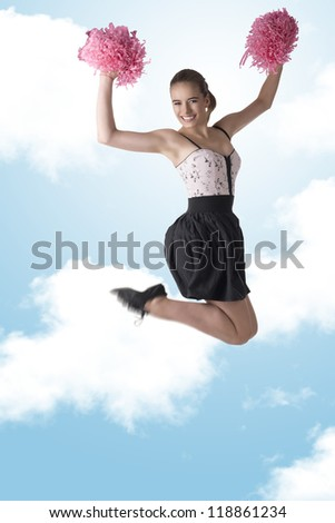 pretty cheerleader jumps with dark skirt and pink pompom - stock photo
