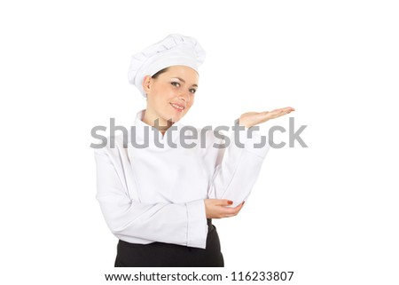 Pretty Chef Cook In Uniform Showing Empty Space On The Open Palm Isolated On White Background (with clipping patch)