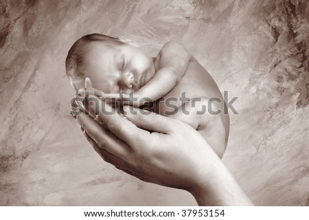 Pretty child is sleeping on the mother's hand. Abstract background.