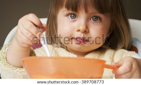 Pretty child toddler eating