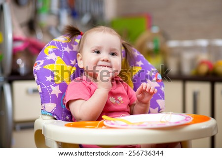 Pretty child toddler eating spaghetti at home - stock photo