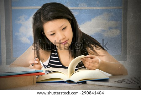 pretty chinese asian young girl reading and studying with school books and computer laptop at home studio desk in education concept - stock photo