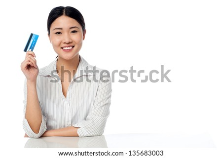 Pretty chinese woman showing her credit card.