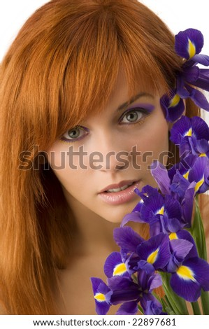 pretty close up of a young and cute red haired girl with purple flowers
