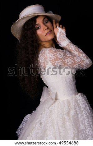 Pretty Colombian woman in a white lace gown