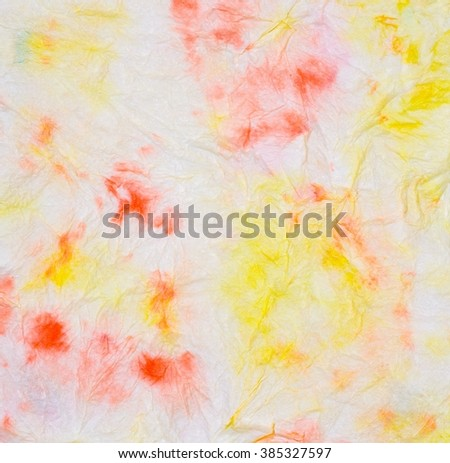 Pretty colored ink stained tissue. Bright yellow, orange and white.
