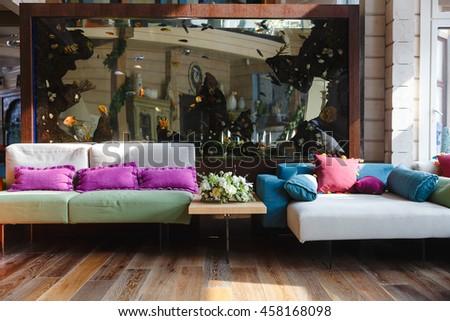 Pretty Colored Sofas Stnad Behind A Big Aquarium Part 87