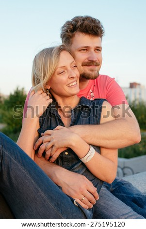 pretty couple embrace outdoor. Handsome bearded man and beautiful slim pretty blonde