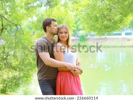 Pretty couple in love outdoors in summer day - stock photo