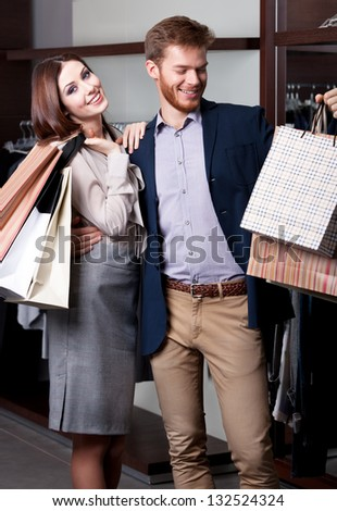 Pretty couple is glad to go shopping - stock photo