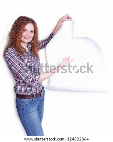pretty curly girl with a poster in a hand on a white background - stock photo