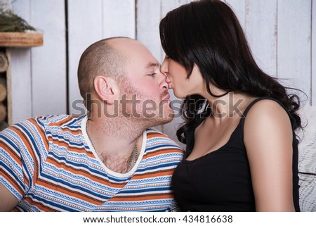 Pretty cute couple in love. close-up portrait girl kissing a guy in the nose - stock photo