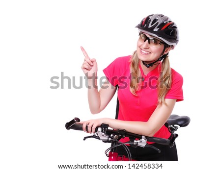 pretty cyclist girl  on white background pointing to the copy space area - stock photo